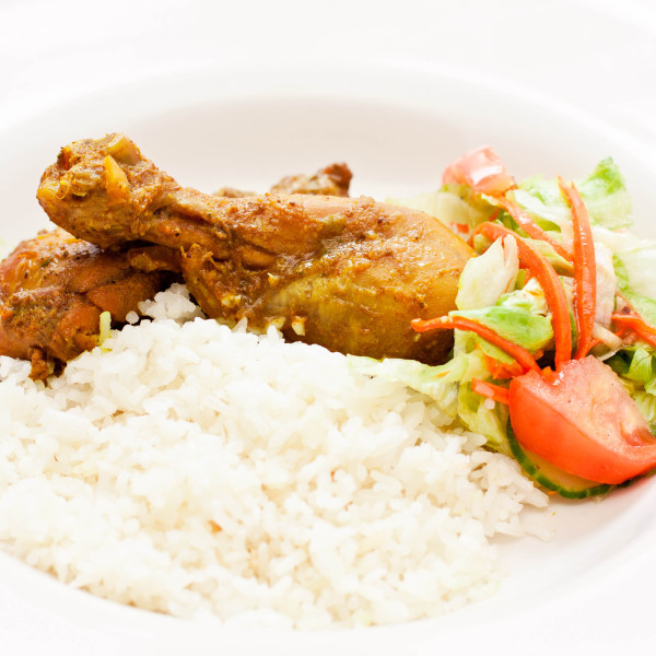 Chicken simmered in delicious curry sauce served with rice and fresh ...