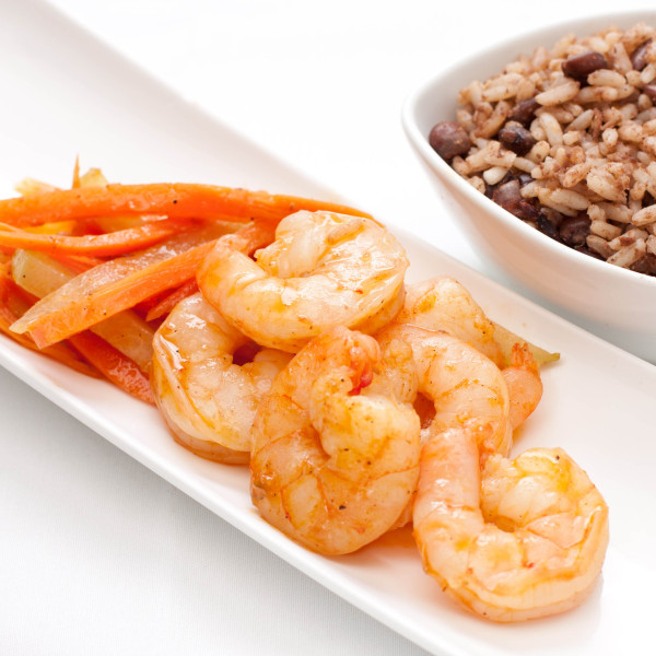 Peppered Black Tiger Shrimp Served With Carrots And Cho Cho Patois